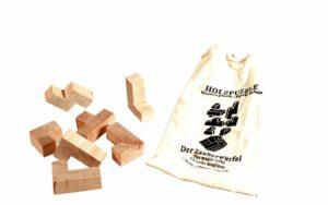 Der Zauberwürfel - Holz Knobelpuzzle im umweltfreundichen Packsack - 7 Teile