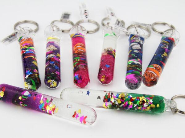 Zauberstab Schlüsselanhänger mit Muscheln oder Fisch.